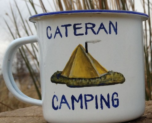 Enamel mug with image of a tipi tent and the words